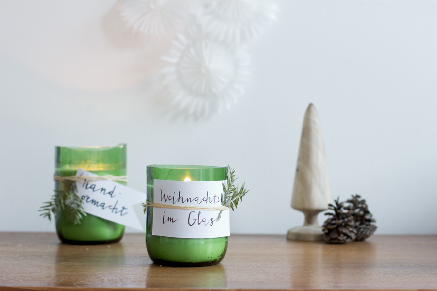 DIY scented candles in jars from upcycled wine bottles.