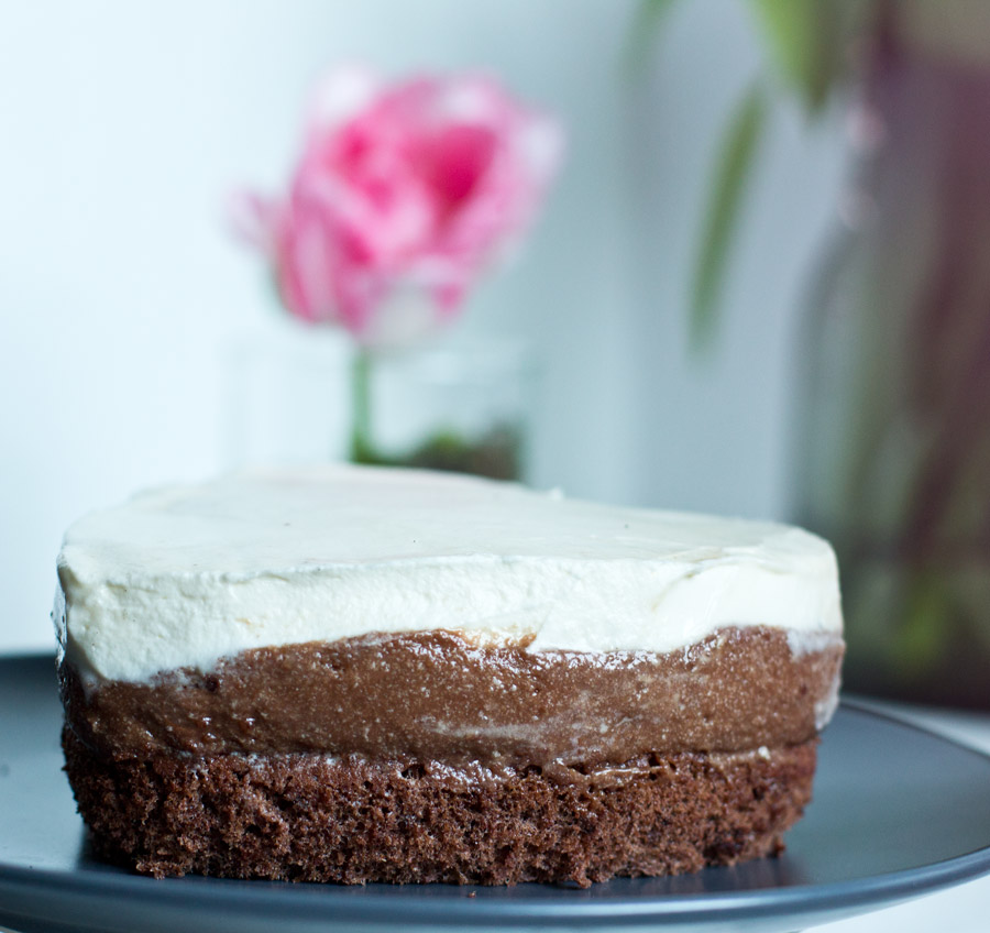 Detail of a chocolate mousse cake with caramel and cream