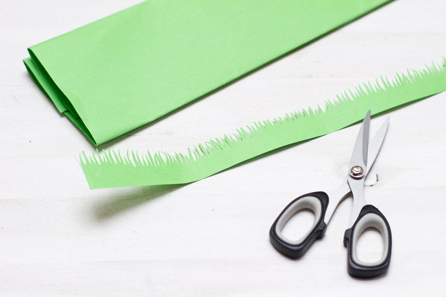 cutting grass out of green paper
