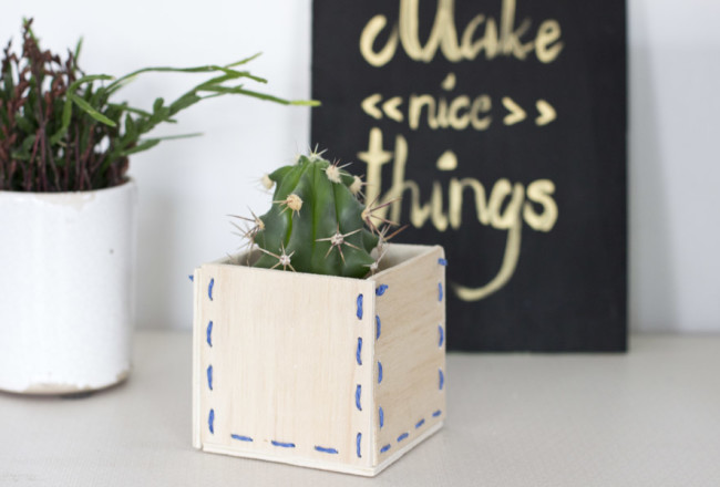 Make a special kind of pot for your plants with this wooden stitched planter DIY.