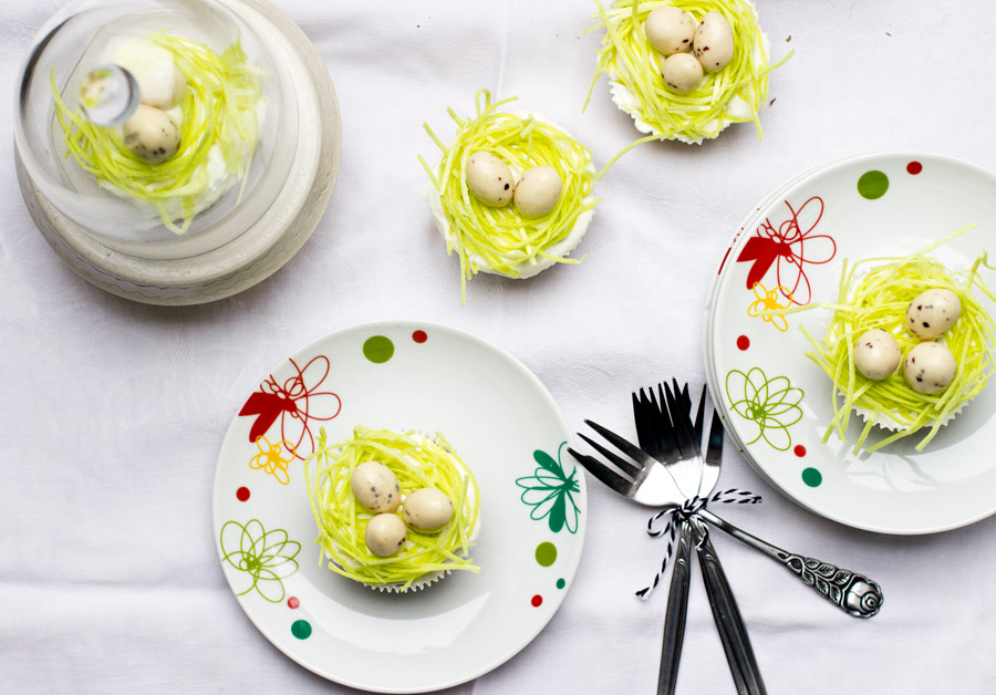 Make this cute poppy and carrot cupcake recipe for an eatable easter table decoration.