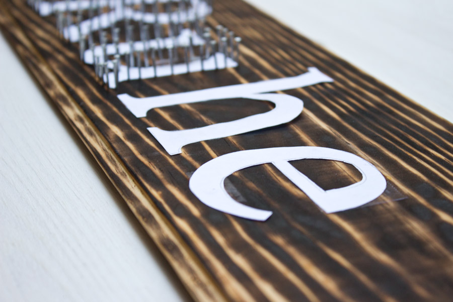 How to make yourself a typography inspired DIY string art sign with just a few easy steps.