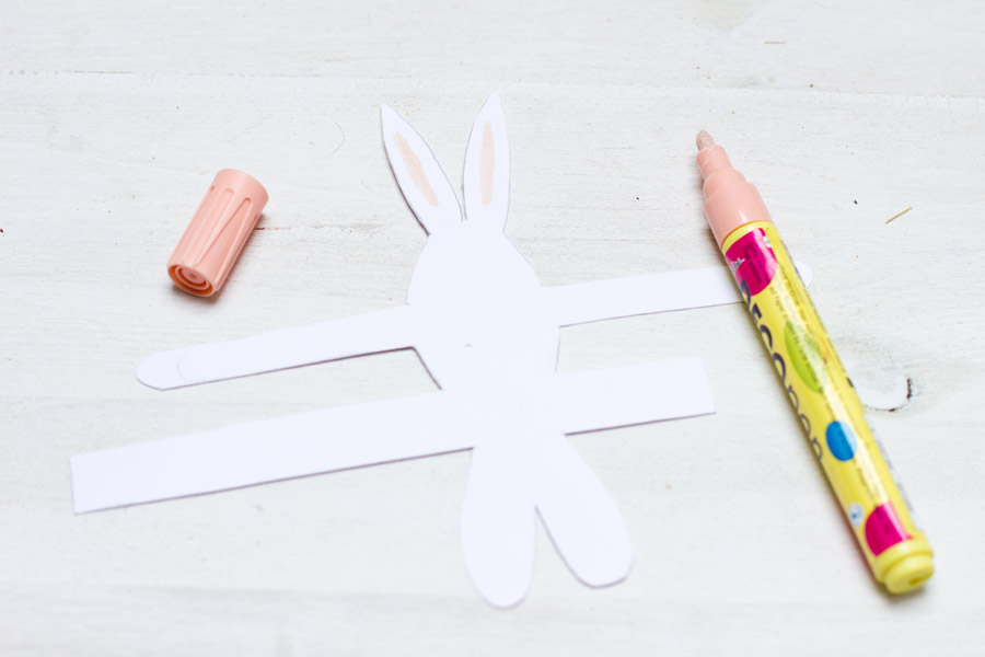 Paint the ears of the paper bunnies.