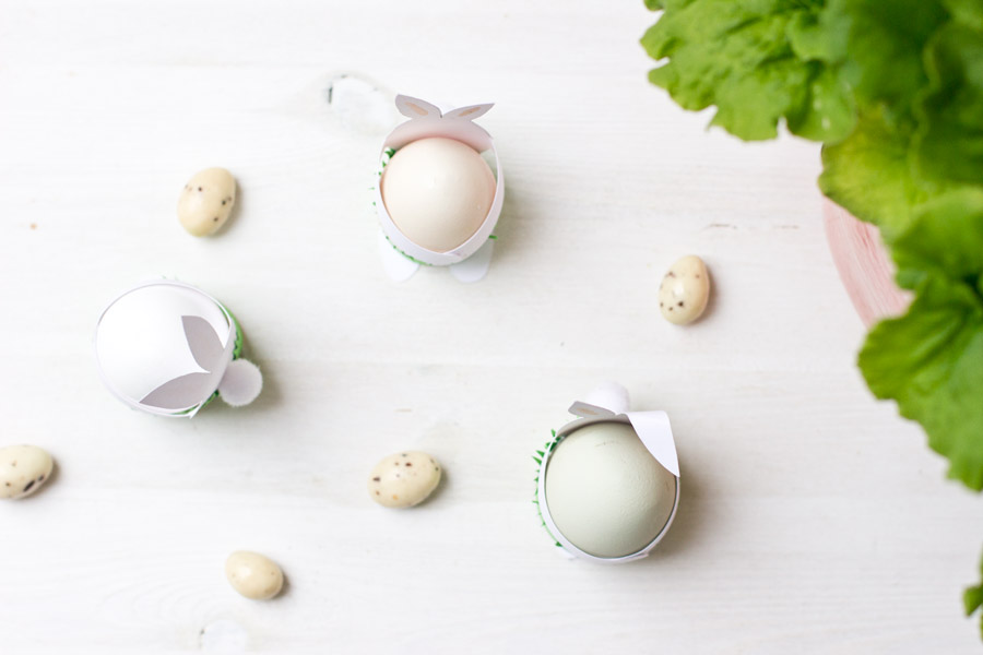 Paper easter bunnies as table decoration and egg cups