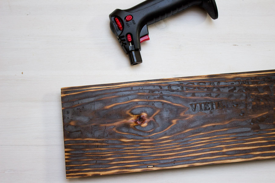 how to torch a wooden board with household materials to get an used look.